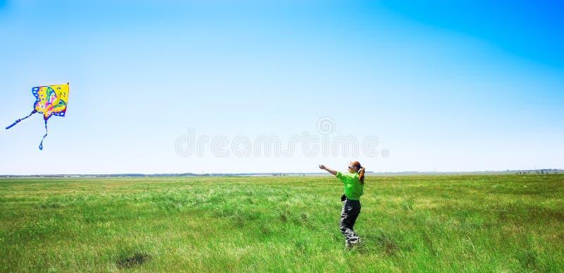 Meisje met vlieger stock foto's