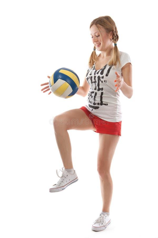 Meisje met volleyballbal stock afbeelding