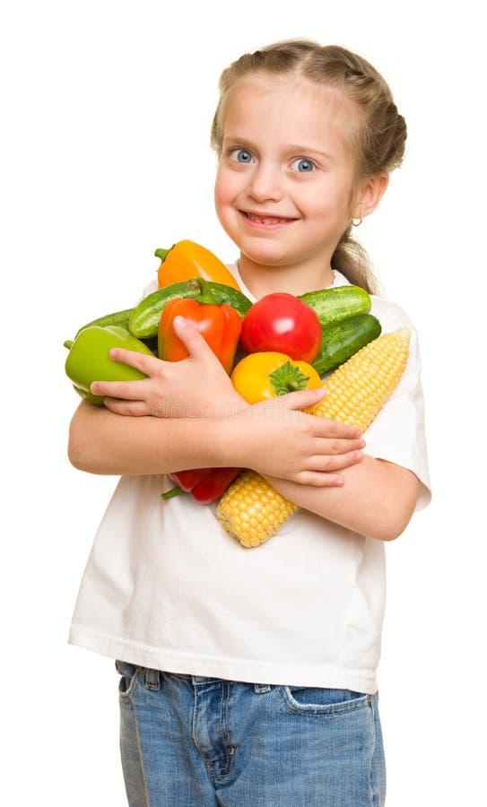 Meisje met vruchten en groenten op wit stock afbeelding