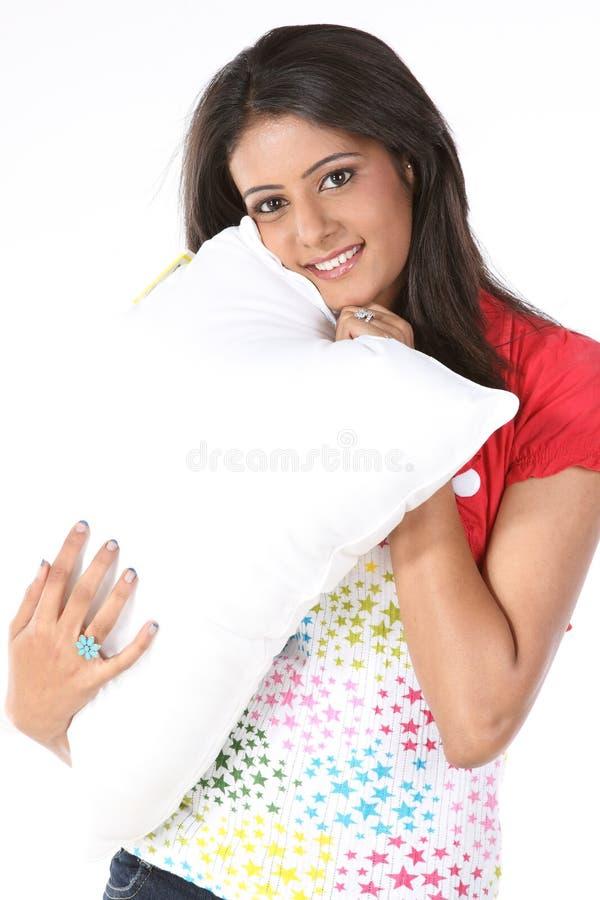Meisje met wit hoofdkussen stock afbeeldingen