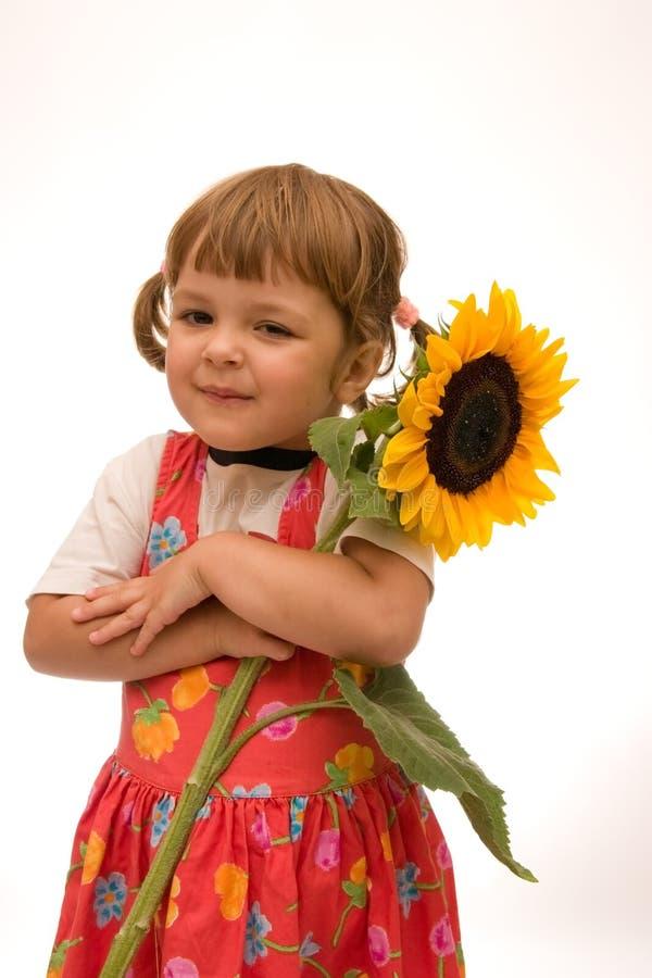 Meisje met zonnebloem stock afbeelding