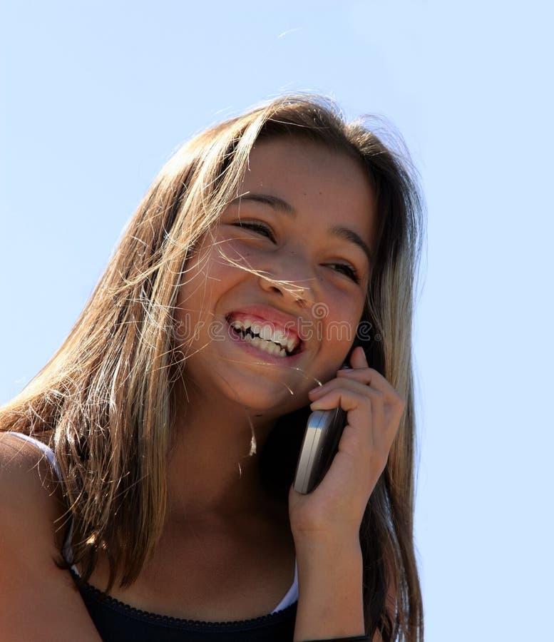 Meisje op de telefoon stock afbeeldingen