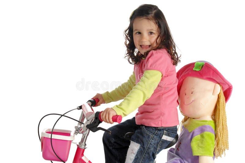 Meisje op een fiets stock afbeelding