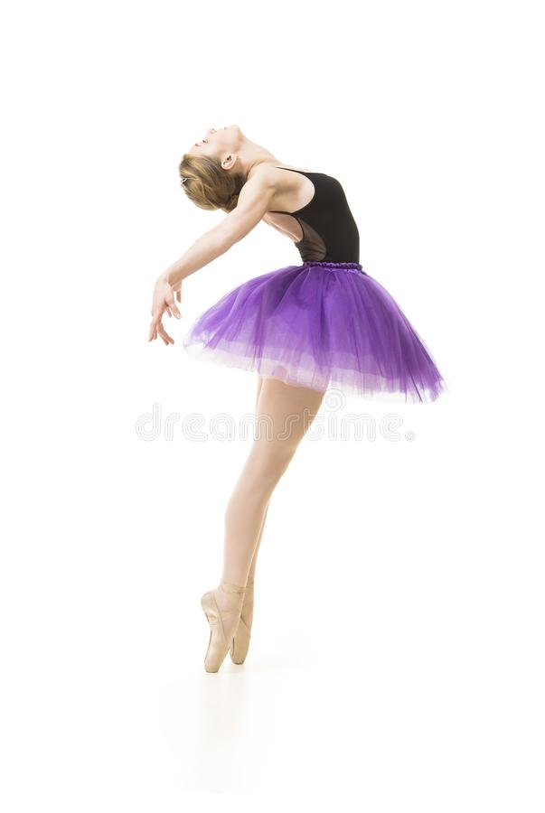 Meisje in purpere tutu en het zwarte ballet van de maillotdans stock foto's