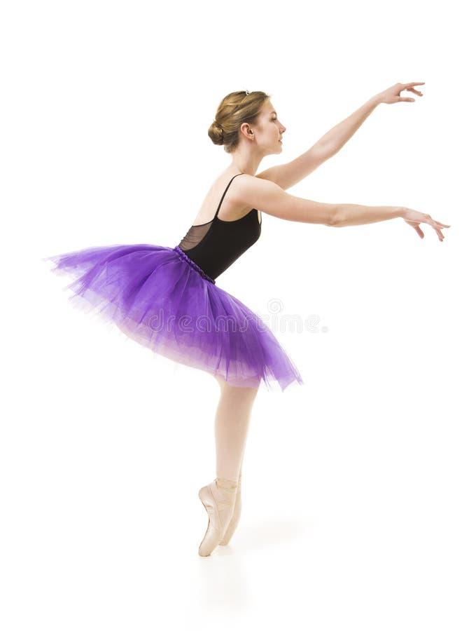 Meisje in purpere tutu en het zwarte ballet van de maillotdans royalty-vrije stock afbeeldingen
