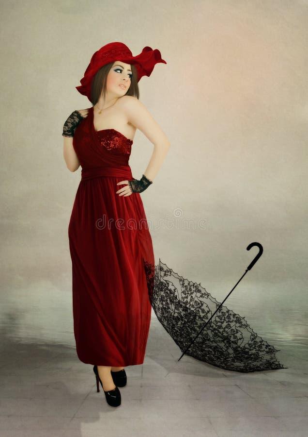 Meisje in rode kleding stock foto's