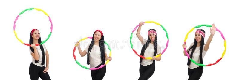 Meisje in sportkostuum met hulahoepel op wit wordt geïsoleerd dat royalty-vrije stock afbeeldingen