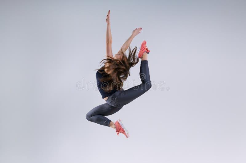 Meisje in sprong stock afbeeldingen