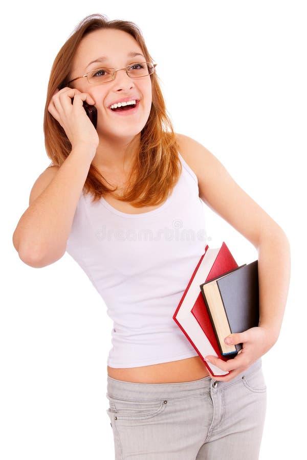 Meisje-student tribune met schrijven-boeken stock foto's