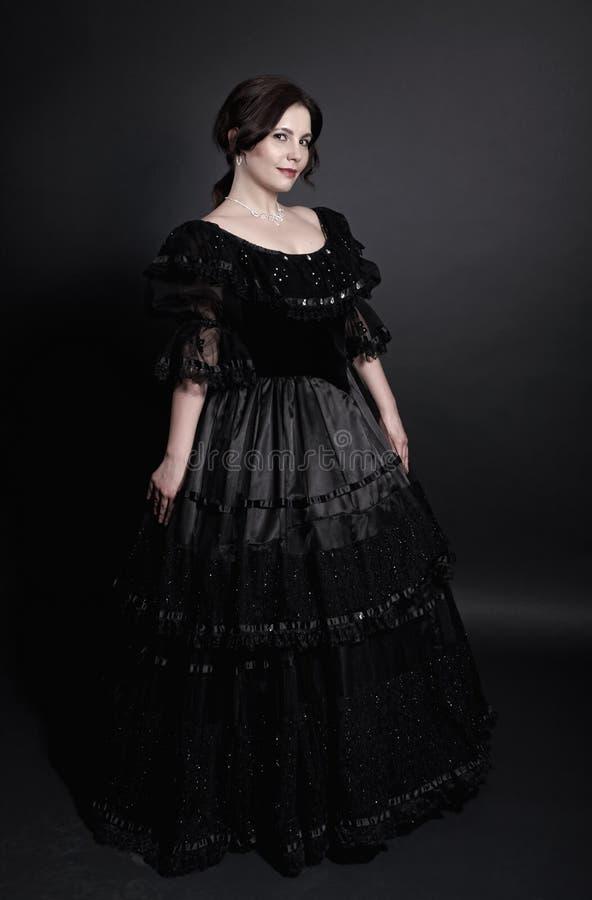 Meisje in uitstekende kleding stock foto's