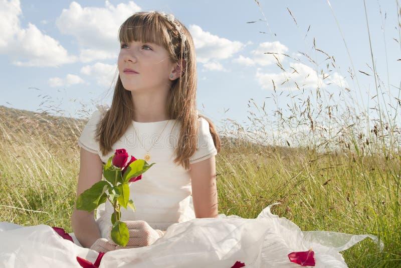 Meisje van de Heilige Communie met nam toe royalty-vrije stock fotografie
