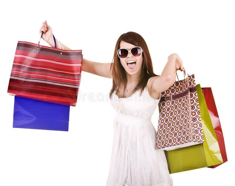 Meisje in witte glazen met het winkelen zak. stock afbeelding
