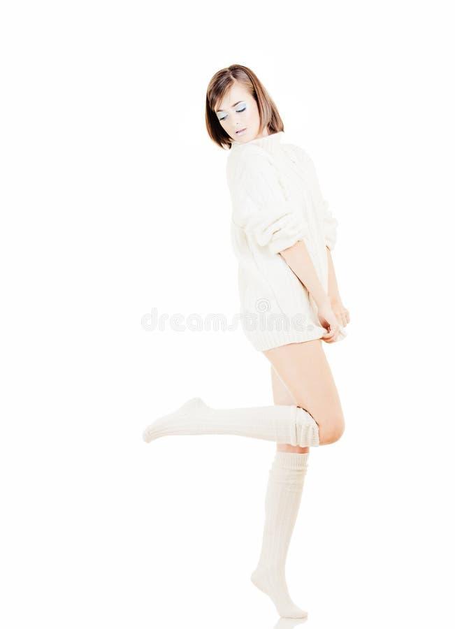 Meisje in witte sweater stock foto's