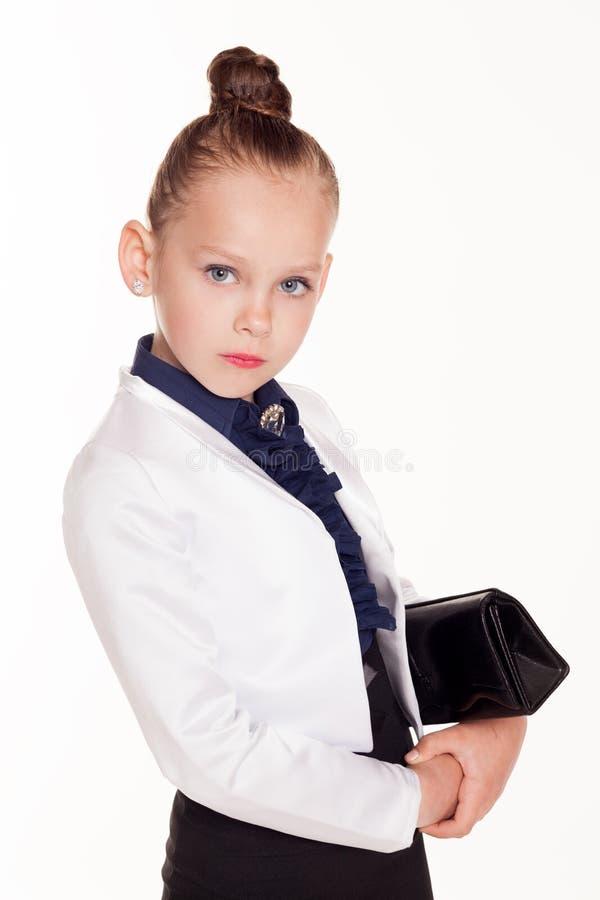 Meisjes bedrijfsdame met een zak op witte achtergrond stock afbeelding
