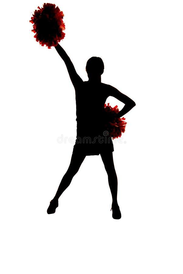 Meisjes cheerleader silhouet met één hand omhoog in lucht stock foto