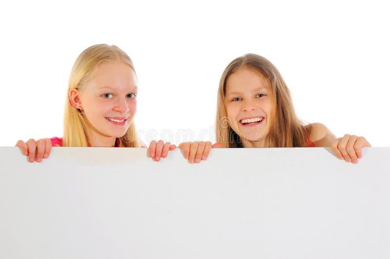 Meisjes die leeg teken houden royalty-vrije stock foto