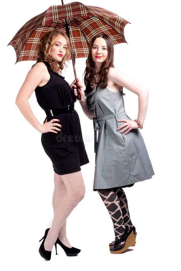 Meisjes en paraplu royalty-vrije stock foto