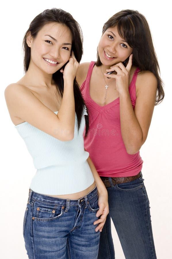 Meisjes en Telefoons 2 stock afbeelding