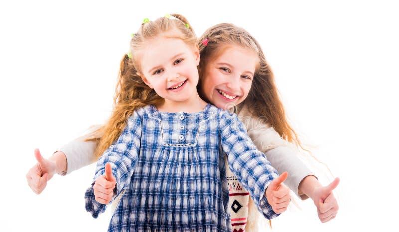 Meisjes het tonen beduimelt omhoog gebaar stock afbeeldingen