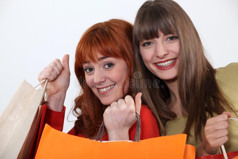 Meisjes het winkelen stock afbeelding
