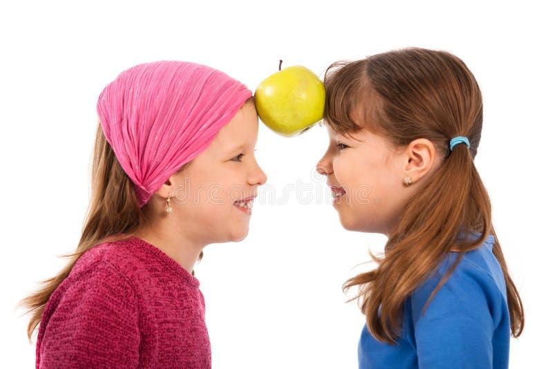 Meisjes met appel royalty-vrije stock foto