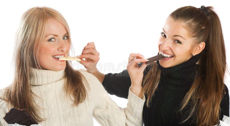 Meisjes met chocolade stock fotografie