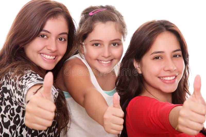 Meisjes met omhoog duim stock foto's
