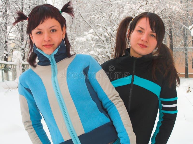 Meisjes met staarten stock afbeeldingen