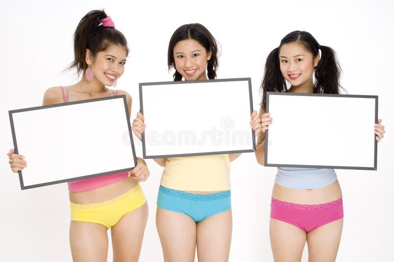 Meisjes met Tekens stock foto's