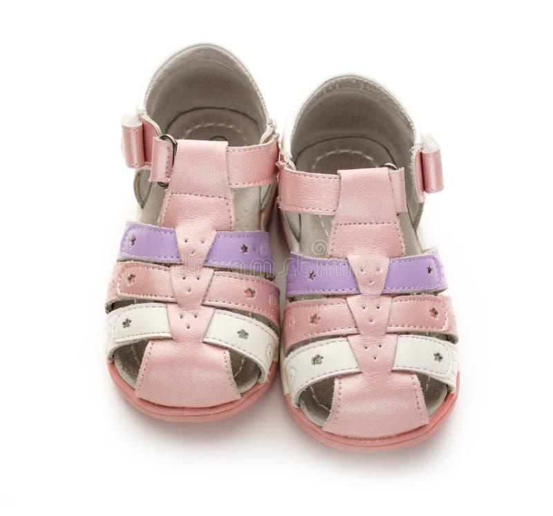 Meisjes` s roze sandals op witte achtergrond royalty-vrije stock afbeelding