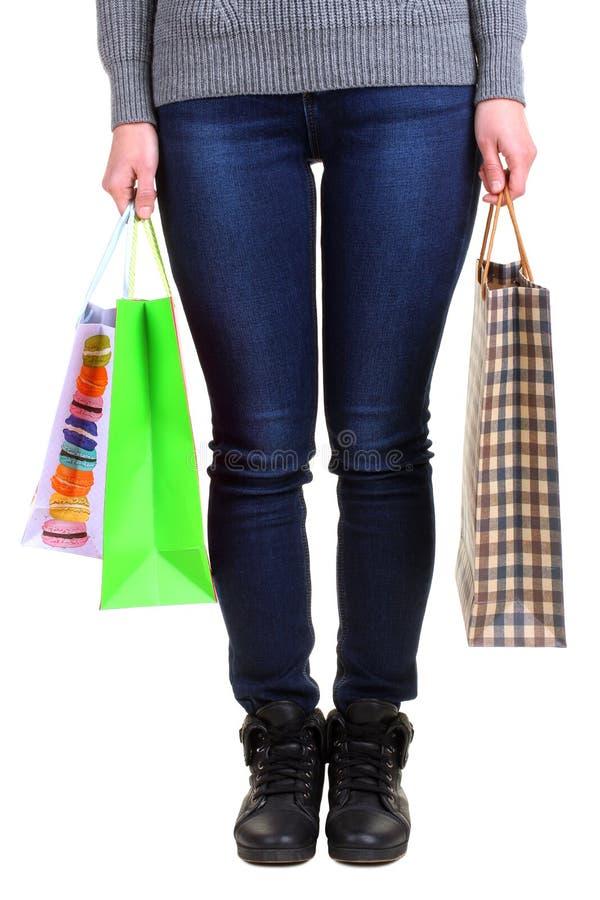Meisjesholding het winkelen zakken royalty-vrije stock foto