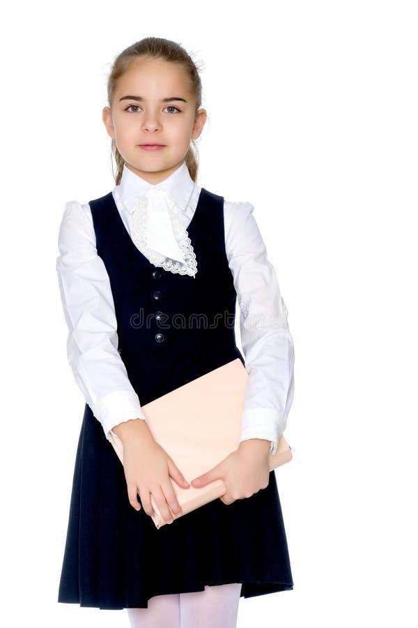 Meisjesschoolmeisje met boek royalty-vrije stock afbeeldingen