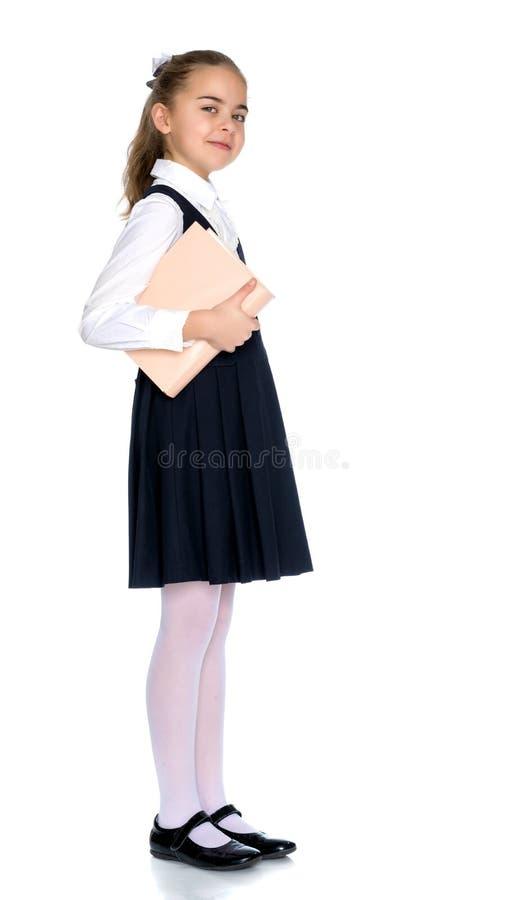 Meisjesschoolmeisje met boek stock afbeeldingen