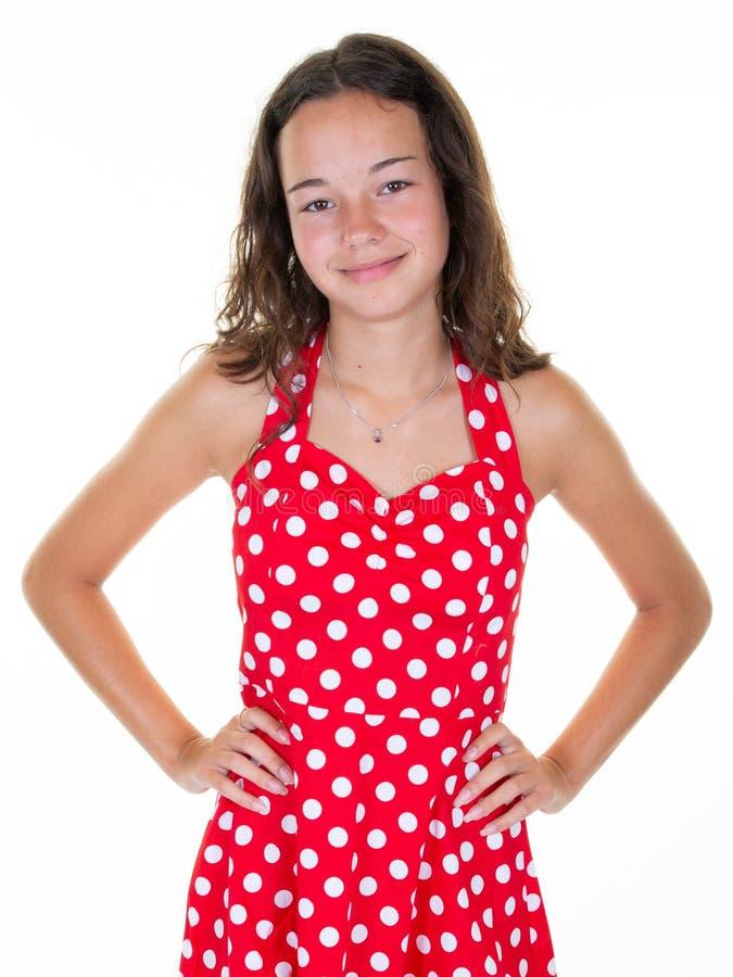 Meisjestiener in uitstekende die kleren van de manier de rode kleding op witte achtergrond wordt geïsoleerd royalty-vrije stock afbeeldingen