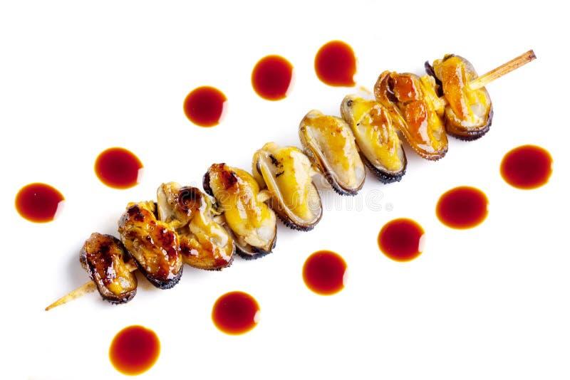 Mejillones fritos imagenes de archivo