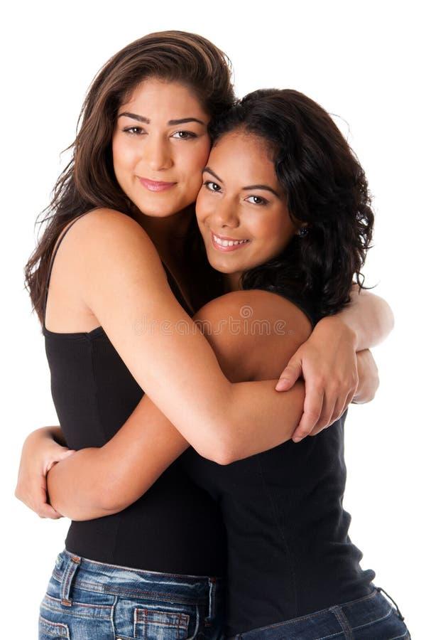 Mejores amigos - abrazo de mujeres fotos de archivo
