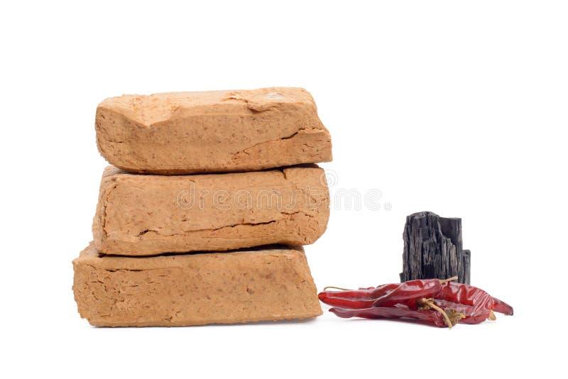 Meju and basic ingredients to make doenjang. Meju (fermented soybean lump) and basic ingredients to make doenjang, isolated on white royalty free stock photography