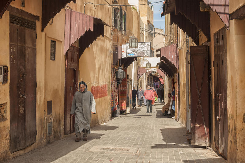 MEKNES, MOROCCO - FEBRUARY 18, 2017: Unidentified people walking in the street of Meknes, Morocco. Meknes is one of the four Imper. Ial cities of Morocco stock images