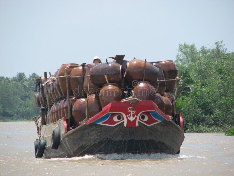 Mekong Delta. Boat transporting ceramic pots on the Mekong Delta in Vietnam stock photos