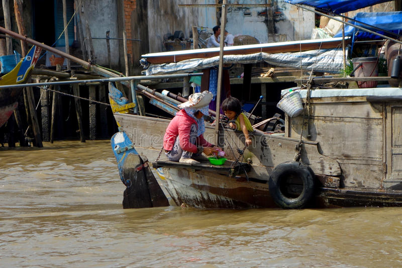 Mekong Delta, Mother with her daughter royalty free stock image
