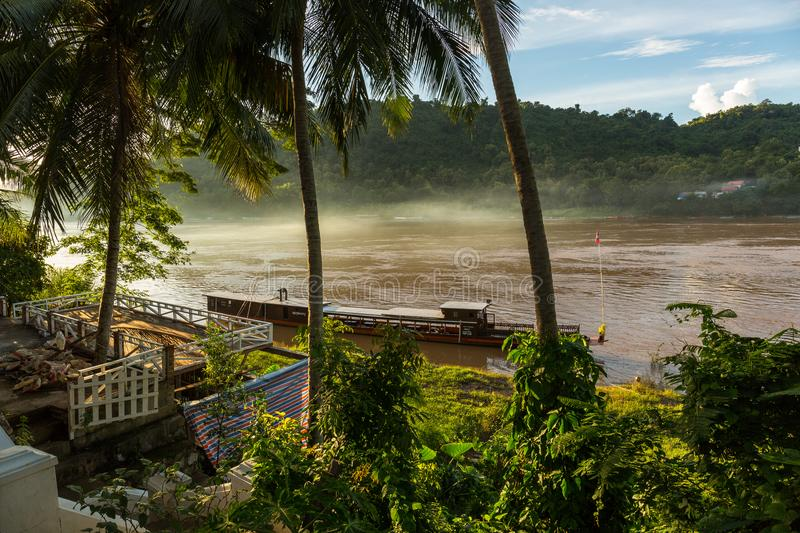 Tour boat on the Mekong River in Luang Prabang, Laos royalty free stock photography
