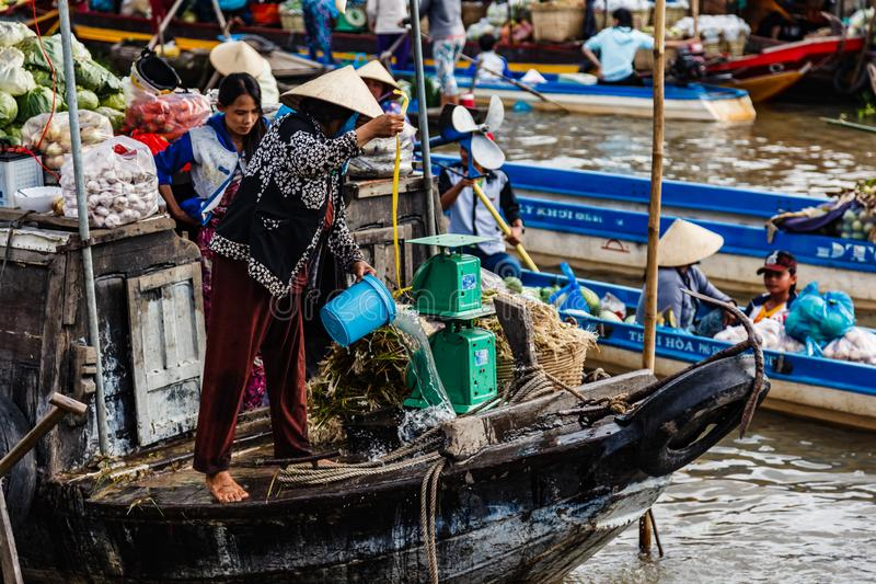Floating market in Mekong River, Vietnam. Mekong River, South of Vietnam. Tam Ban, Sampan, small boat, a traditional popular transportation of the region. Small stock image
