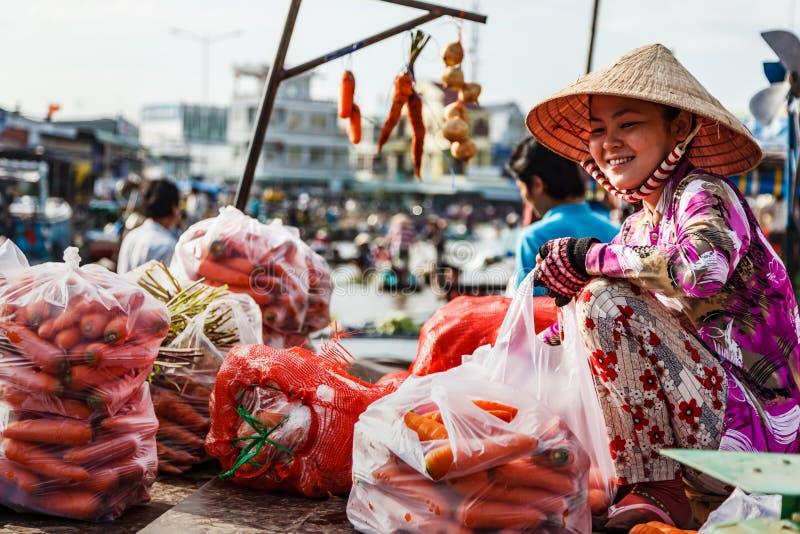 Floating market in Mekong River, Vietnam. Mekong River, South of Vietnam. Tam Ban, Sampan, small boat, a traditional popular transportation of the region. Small stock photos