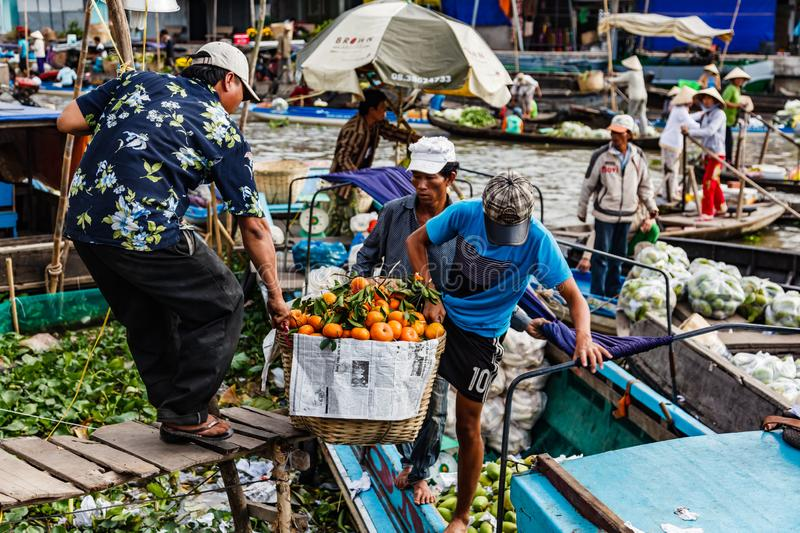 Floating market in Mekong River, Vietnam. Mekong River, South of Vietnam. Tam Ban, Sampan, small boat, a traditional popular transportation of the region. Small royalty free stock images