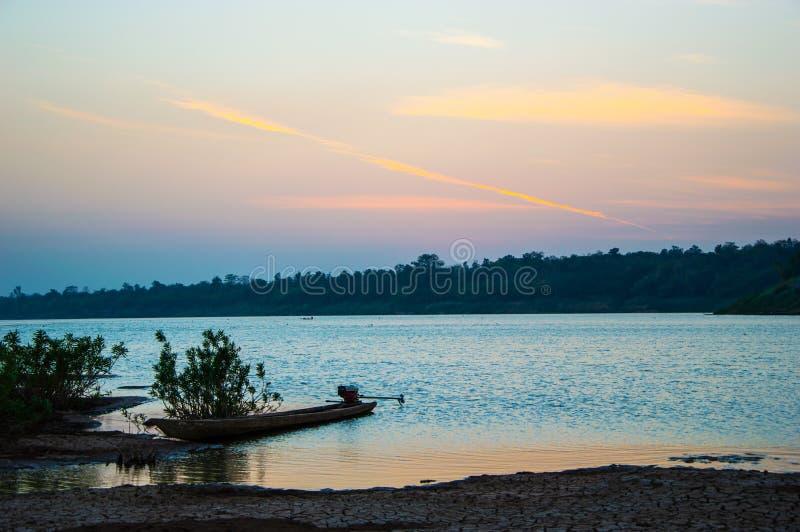 Mekong River in sunset. Boat Park Banks the Mekong River in sunset royalty free stock images