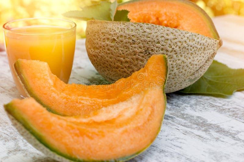 Melão fresco, saboroso e suculento - suco do cantalupo e do melão imagem de stock royalty free