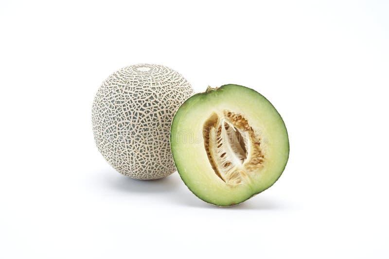 melón del cantalupo en el blanco foto de archivo