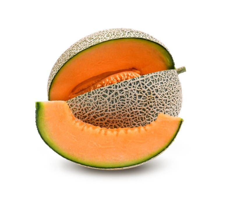Melón o cantalupo anaranjado con las semillas en el backgrou blanco fotos de archivo