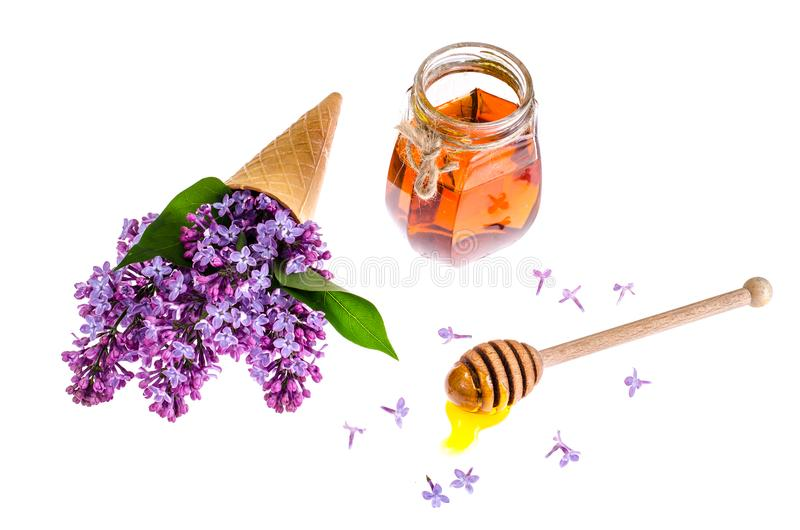 Mel orgânico no frasco de vidro, lilás roxo fotografia de stock