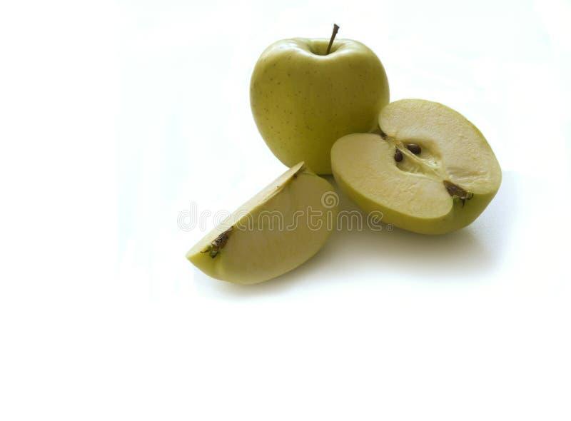 Mela di Flavovirent e la mela flavovirent del taglio immagine stock